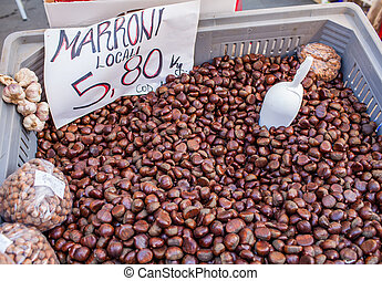Chestnuts Sale - Marron chestnuts on sale in market stall.