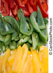 Sliced three color  green red yellow peppers