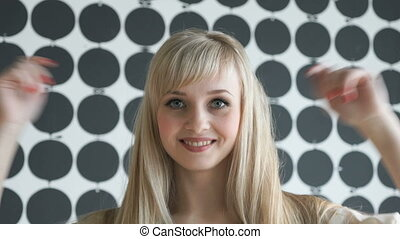 Blonde girl with a thick hair at the beauty salon - Slim...