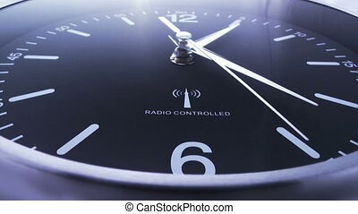 Clock time lapse 4 - Time. Closeup of a black office clock.