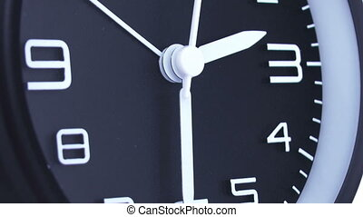 Clock time lapse 5 - Time. Closeup of a black office clock.