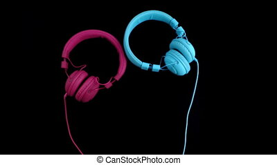 Two headphones - one heart. Stop motion - A pair of...