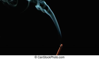 Joss stick with smoke - Joss stick on black background