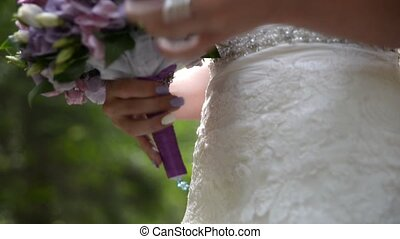 Romantic Wedding Concept Bride Holding bouquet of flowers...