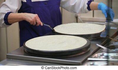 Process of pancake turning on one side to other