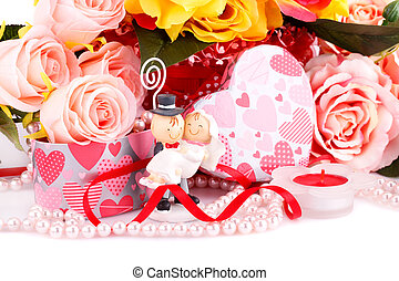 Wedding day - Colorful roses, bride and fiance, candle and...
