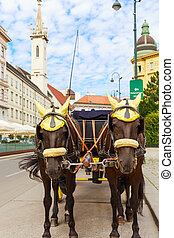 Vienna. A carriage with two horses - Austria. Vienna. A...