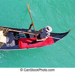 Gondolier - Venice. Italy. Young gondolier rowing a gondola
