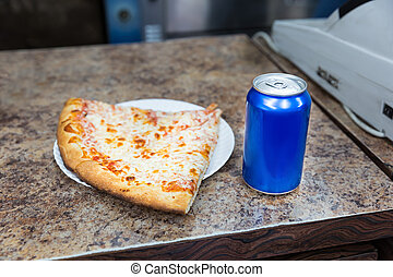 Pizza slice and bank of soda