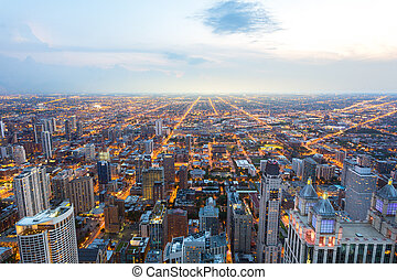 Aerial view of Chicago downtown at sunset from high above,...