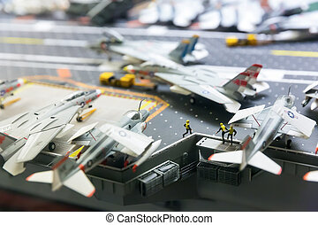 Miniature model of aircraft carrier runway with planes and...