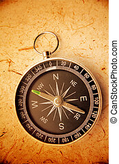 Compass - Single compass on brown background