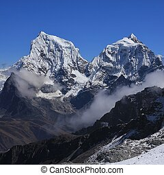 Mount Cholatse and Taboche Peak - High mountains in the...