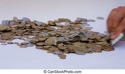 Lots of coins - A person with a credit card collects a lot...