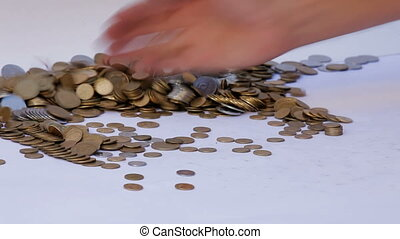 Money movement - A man with his hands collects a lot of...