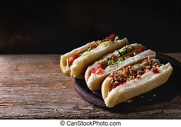 Assortment of homemade hot dogs with sausage, fried onion,...