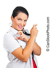Happy woman holding fingers crossed - Happy woman standing...