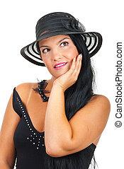 Dreaming elegant woman in black