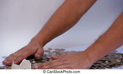 Treasure - A man collects money with his own hands.
