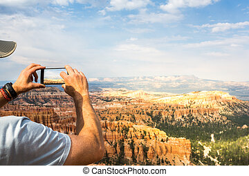 Traveler take pictures at monument valley. Blue sky on the...
