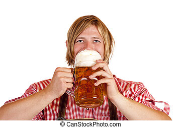 Happy Bavarian man drinks out of oktoberfest beer stein...
