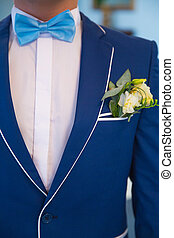 Blue suit with a butterfly