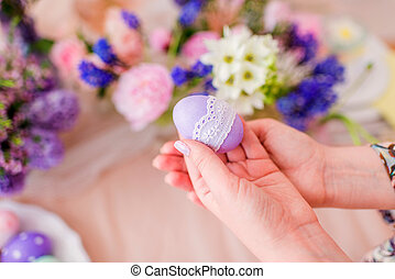 in the hands of beautiful Easter eggs