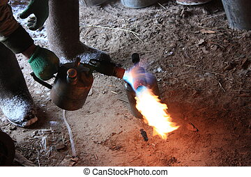 blowtorch - heating of the blow torch in the winter frost,...