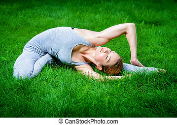 deep breathing - Beautiful young woman doing yoga in the...