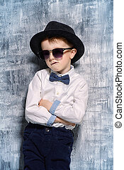 be like daddy - Cute little boy in elegant clothes and...