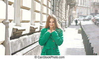 Cute woman walks, poses, flirting and smiles in the city....