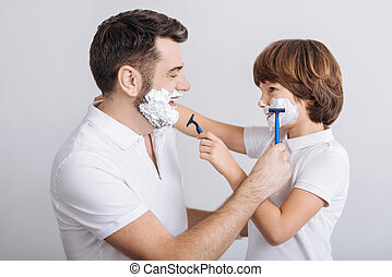 delighted man and boy going to shave - Try it. Handsome...