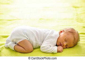 One week old newborn baby on blanket