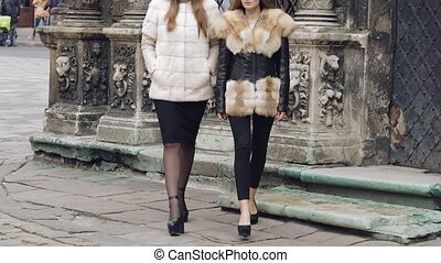 Two assured models walking runway in furry coats on the...