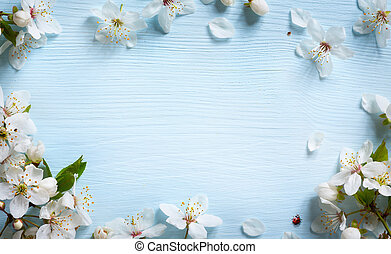 art spring background; fresh flower on blue background -...