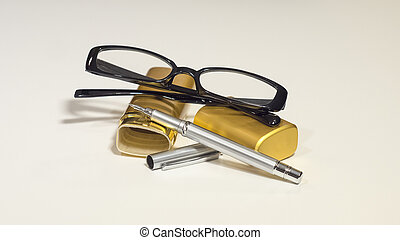 Elegant black glasses, case, metal pen. White isolate. - An...