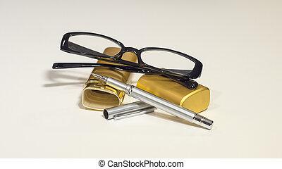 Elegant black glasses, case, metal pen. White isolate. - An...