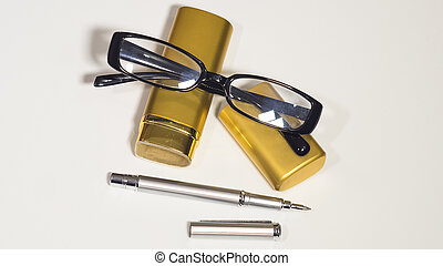 Glasses, gold case and a pen. Isolate white background. -...