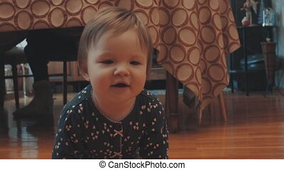 Little baby girl crawling, smiling and waving her hands