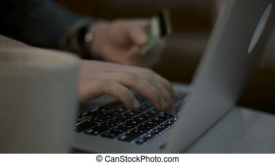 Shopping online concept. Woman hands holding credit card and using laptop.