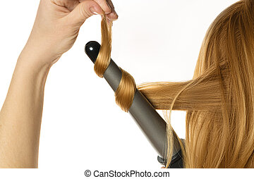 Woman makes a curling hair by herself - Woman with red hair...
