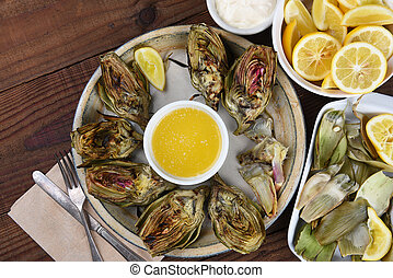 Eating Grilled Artichokes - High angle view of a plate full...