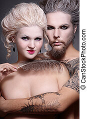Gothic couple - Portrait of pierced tattooed man and woman...