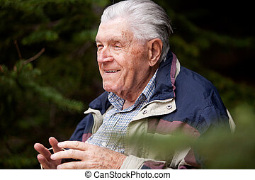Grandfather Portrait - A grandfather telling a story in the...