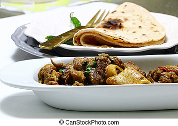 Mutton curry and chapati - A bowl of mutton curry or Rogan...
