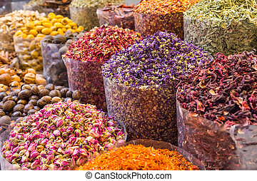 Spices and herbs being sold on Morocco traditional market. -...