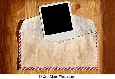 Envelope and polaroid