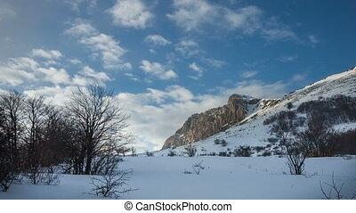 Rock Eklizi Burun under a blue sky with clouds. Timelapse. Crimea. Russia