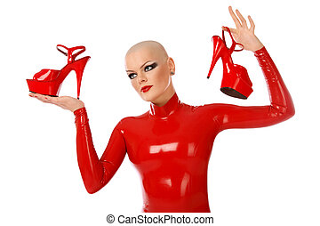 Shoes maniac - Skinhead girl in red latex catsuit holding in...