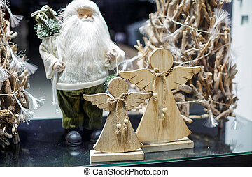 Santa Claus and Christmas angels in the showcase of store